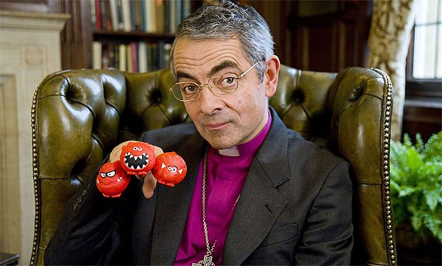 Rowan Atkinson - wearing a big purple dress every day! (Radio Times image)