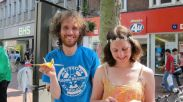 Action AWE: against atomic weapons. Street performance, knitting and origami crane making