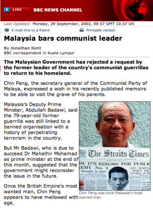 CHIN Peng with the front page news on his bounty.