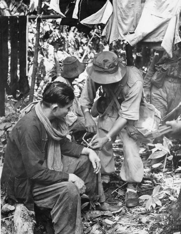 Two suspected communist terrorists after capture by a Malayan Police patrol in the jungle.