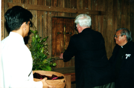 Bernard Stogden: Placing his father's Changi Cross at the altar. A poignant moment in history.