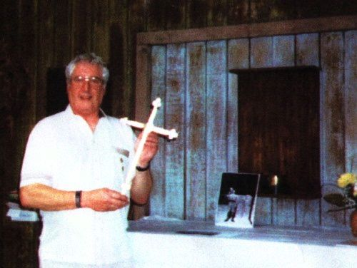 Bernard Stogden holding the Changi Cross that his father Harry Stogden made in 1942 at Changi. (Image credit: Bernard Stogden)