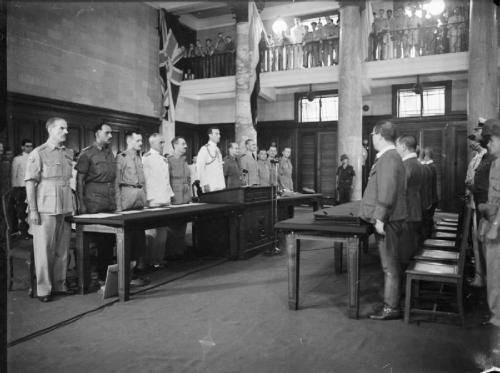 The Allied delegation led by Admiral Lord Louis Mountbatten face the Japanese delegation led by General Itagaki across the table, for the signing of the surrender at Singapore. © IWM (A 30491)