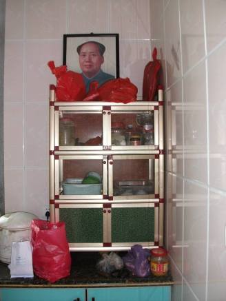 Chairman Mao's picture is still in many houses.