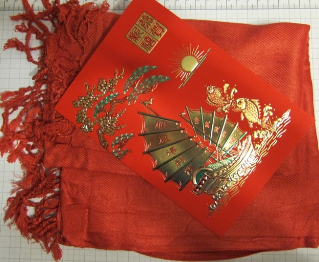 My friend Hazel knows about Chinese culture - she bought me this red scarf and a red greeting card this year.